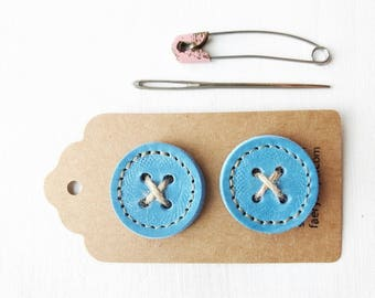 Big leather handmade borrower BUTTONs on gift tag. Perfect for all knitwear. 30mm X 2 in blue skies