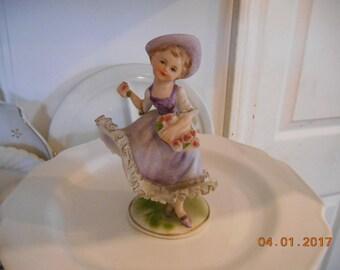 Vintage Porcelain Ardco Figurine little girl in purple dress holding flowers