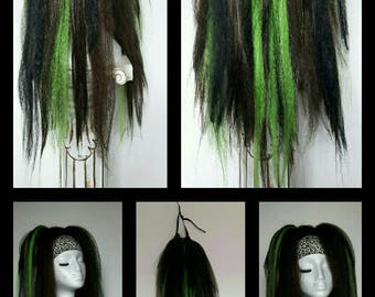Pair of massive black, brown and neon green hair falls on strong elastic