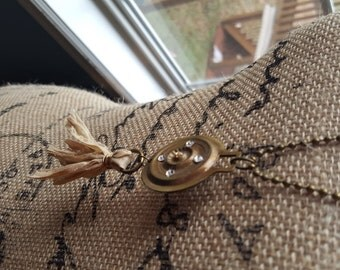Brass Pendant with swarovski crystals and sari ribbon tassel -mixed media