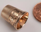 14kt gold THIMBLE (tested and guaranteed as described):  c. 1940's with swirl, floral and tiny star designs -  2.9 grams