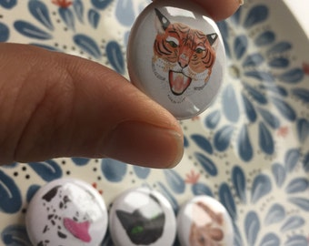 Four super floof animal 25mm badges