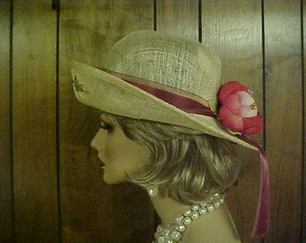 Straw hat with large fabric flower and ribbon band fits 22-23""