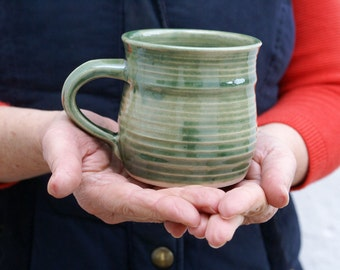 Two bellied stoneware pottery coffee mugs - glazed in forest green