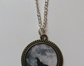 Wolf howling at the full moon necklace