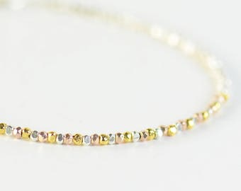 Sterling silver 3 gold colors nuggets beads bracelet.Sterling silver clasp