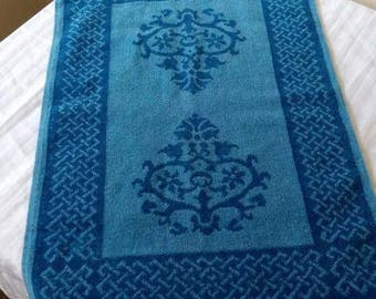 1960s blue hand towel with scroll work.