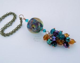 Glass waterfall pendant, rainbow pendant, multicoloured necklace, lampwork pendant, teal and amber pendant, purple pendant, round glass