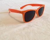 Orange vintage sunglasses, wayfarer style shades, plastic frame, dark opaque lenses, sun eyewear, made in Taiwan, pizazz