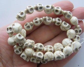 40 White howlite skull beads