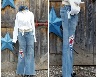 """Levis, bell bottom, patched and hand embroidered  jeans, size 31"""""""
