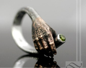 Get a hold of Yourself! - A Sculptural silver and bronze Ring