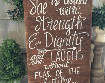 she is clothed with strength and dignity and she laughs without fear of the future wooden sign