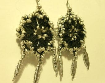 Black tatted lace and bead earrings with feathers