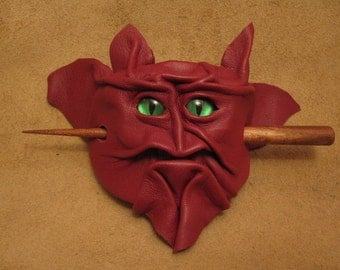 Grichels leather hair thing stick barrette - Krampus red with custom green metallic slit pupil eyes