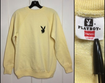 Vintage 1970's black embroidered Playboy Bunny Logo Hanes Sweatshirt size Large pastel yellow