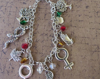 Garden Of Eden Themed Silver Charm And Crystal Bracelet