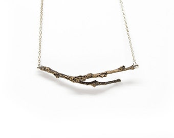 tree twig in bronze with a sterling silver chain