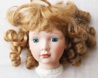 Vintage Bisque doll head with Glass eyes and Curly Hair     -   G
