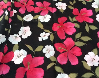 Floral semi sheer fabric, black background with pink flowers