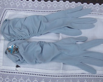 Vintage Powder Blue Fabric Gloves. With Original Paper Tag Attached. Made in Canada by Kayser. 6 1/2. Will Fit 7 Also. Kaysuede.