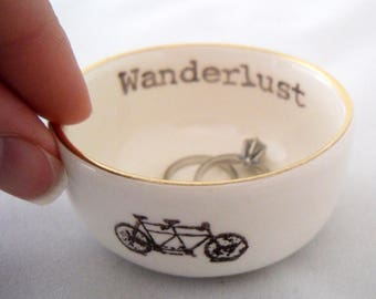 tandem bicycle ceramic wedding ring dish or engagement ring holder, printed with wanderlust text with a gold or silver rim, add custom color