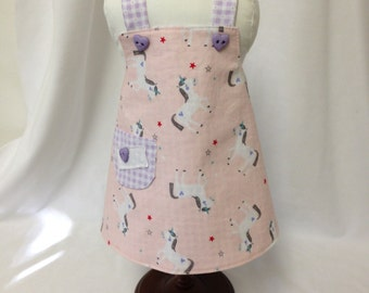 Doll Apron to fit 18 inch dolls--Fabric has Unicorns Prancing on the Pink Background
