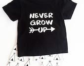 Never grow up shirt and tee pee pants.