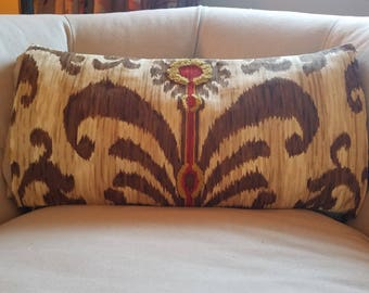pillow cover in brown and yellow ikat print