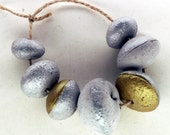 The idea of deserving -- a set of 7 large, chunky, metallic and matte grey ceramic  beads