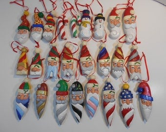 New for 2017 Hand Carved Wood Santa Head Ornaments: Twisty hat, Twisty Beard, Snowman, Candy Cane, Big Nose, Swirl Beard, Kinked Hat