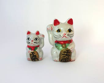 Vintage Japanese Maneki-neko pearly white lucky cat ceramic figurine piggy bank, beckoning cats