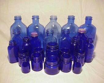 c1930s -1950s Collection Group Lot of 24 Embossed Cobalt Blue Glass Medicine Bottles, Great Wedding for Decor No. 1