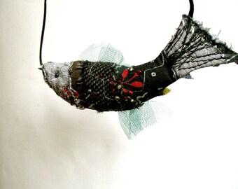 Fish pendant in dark colors