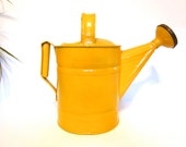 Vintage galvanized metal watering can, garden tools, painted yellow/orange