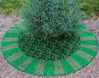 A Holly Berry Masterpiece Quilts Christmas Tree Skirt