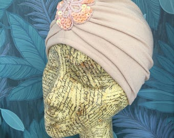 Beige nude vintage style turban with flower detail