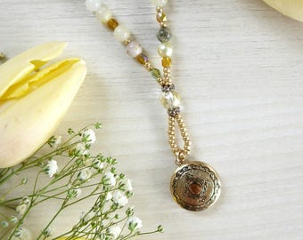 Brass locket-necklace with beaded necklace in yellow and green