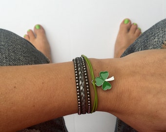 shamrock bracelet with silver braid and black and green accents. lobster clasp chain closure. St. Patrick's Day shamrock charm.
