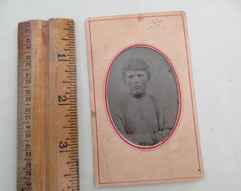 antique tintype with paper frame - young man with suspenders