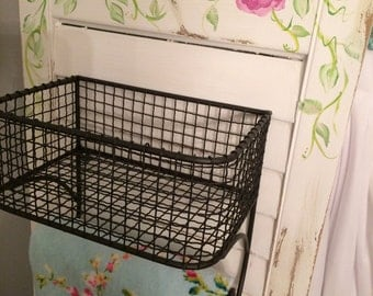 Kitchen or bathroom wall storage, hanging baskets with towel holders on a vintage shutter