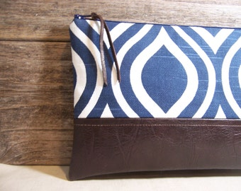 Clutch made with a navy blue modern fabric  and a faux leather , Great large size , everyday bag, vegan bag