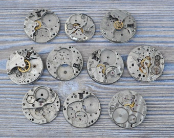 0.9 inch Set of 10 vintage wrist watch movements.