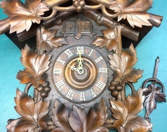 Large nicely carved antique Black Forest German  animated Cuckoo and quail clock circa early 1900s