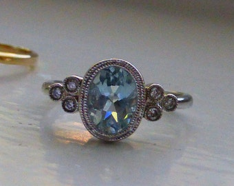 14k Natural Aquamarine and bezel set diamond ring