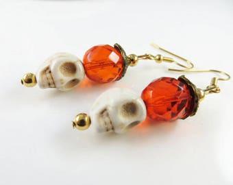 Orange skull earrings