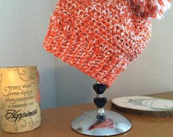 Orange and white slouchy beanie with pom-pom