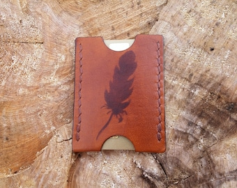 Leather card holder with feather