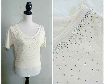 Glimmer in the Sky 1950s Fitted Cream Sweater with Black Metal Studs & Multi Colored Rhinestone Detail