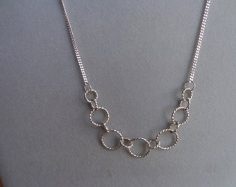 Silver .925, twisted ring necklace.